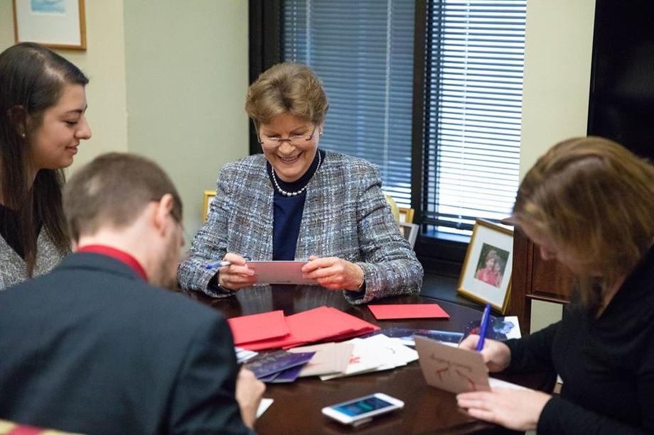 Senator Shaheen and her staff signing holiday cards for the Cards 4 Our Military-NH Challenge.